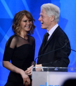 Actress Jennifer Lawrence presents Former President of the United States Bill Clinton with the Advocate for Change Award onstage during the 24th...