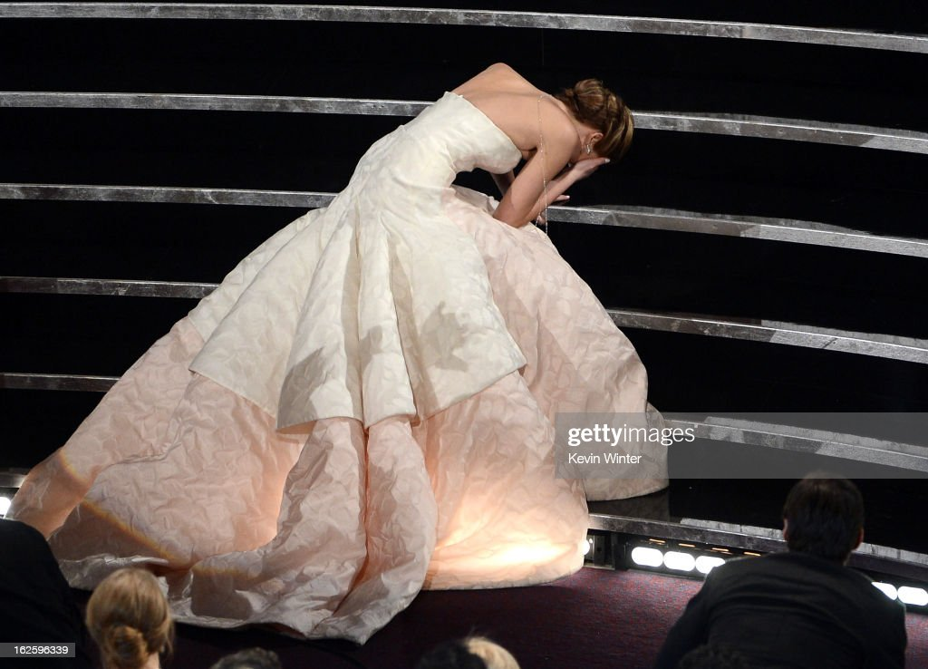 Actress Jennifer Lawrence reacts after winning the Best Actress award for 'Silver Linings Playbook' during the Oscars held at the Dolby Theatre on...