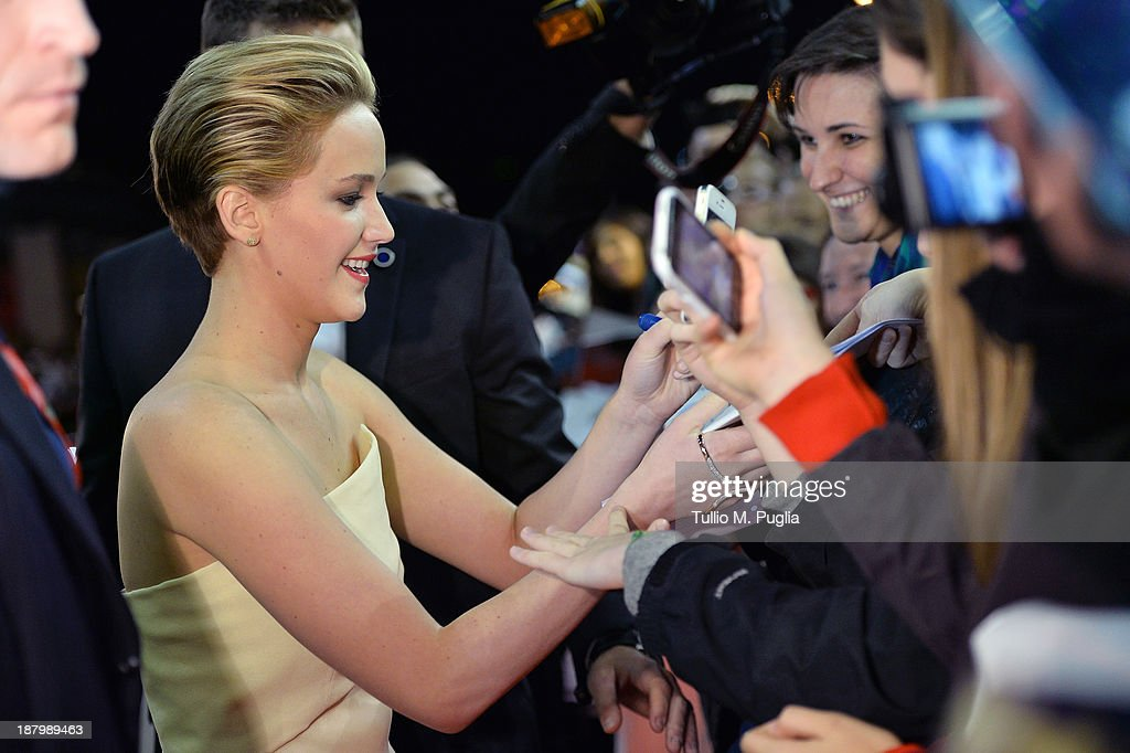 Actress Jennifer Lawrence signs autographs as she attends the 'The Hunger Games: Catching Fire' Premiere during The 8th Rome Film Festival at Auditorium Parco Della Musica on November 14, 2013 in Rome, Italy.