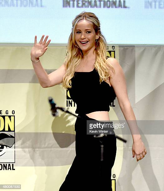 Actress Jennifer Lawrence waves at the audience during at the 'The Hunger Games Mockingjay Part 2' panel during ComicCon International 2015 at the...