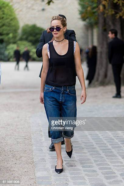 Actress Jennifer Lawrence wears a sheer top cropped denim jeans and pointed flats outside of Dior on September 30 2016 in Paris France