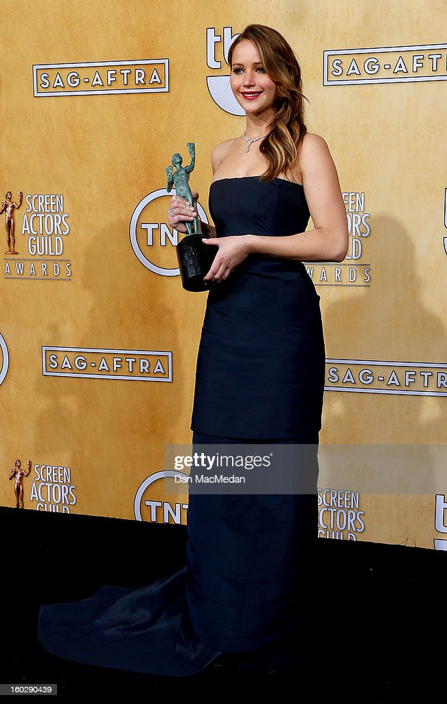 Actress Jennifer Lawrence, winner of Outstanding Performance by a Female Actor in a Leading Role for 'Silver Linings Playbook,' poses in the press room at the 19th Annual Screen Actors Guild Awards at the Shrine Auditorium on January 27, 2013 in Los Angeles, California.