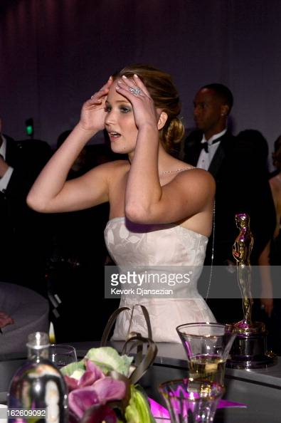 Actress Jennifer Lawrence winner of the award for Best Actress for her performance in 'Silver Linings Playbook ' attends the Oscars Governors Ball at...