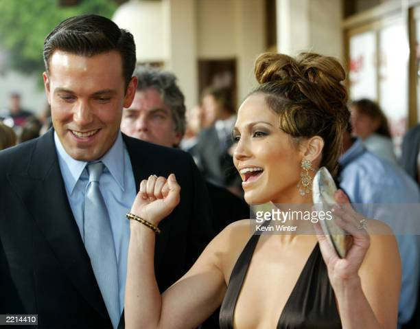 Actress Jennifer Lopez and actor Ben Affleck attend the premiere of Revolution Studios' and Columbia Pictures' film 'Gigli' at the Mann National...