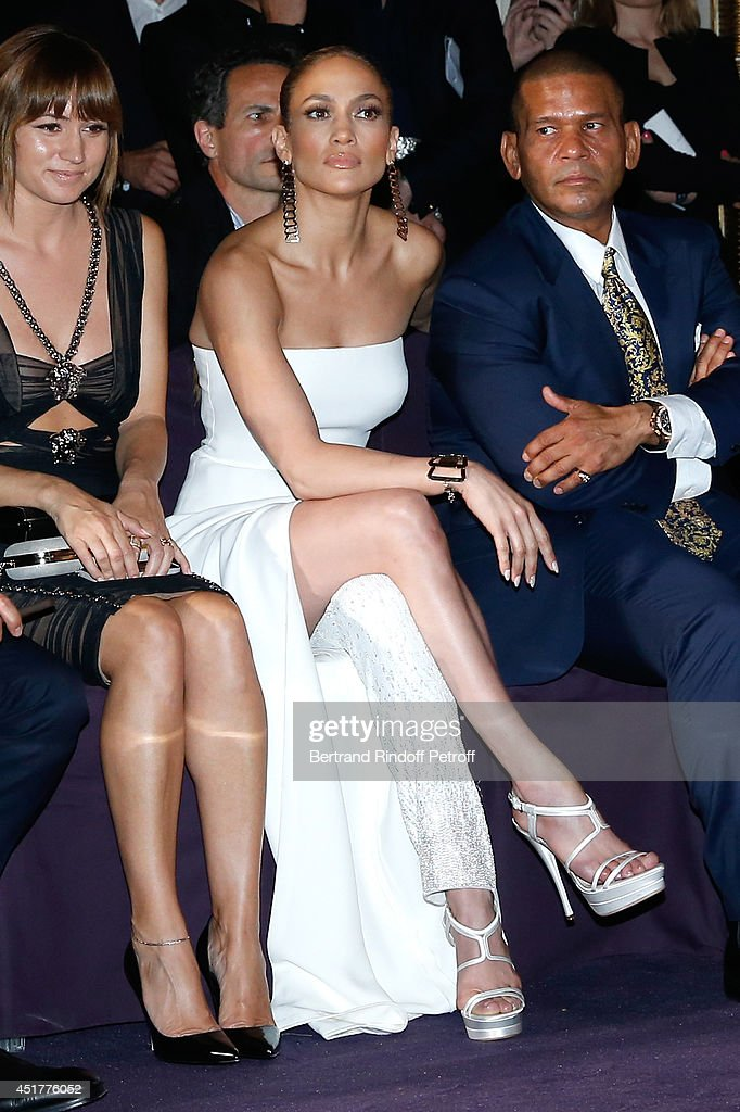 Actress <a gi-track='captionPersonalityLinkClicked' href=/galleries/search?phrase=Jennifer+Lopez&family=editorial&specificpeople=201784 ng-click='$event.stopPropagation()'>Jennifer Lopez</a> and <a gi-track='captionPersonalityLinkClicked' href=/galleries/search?phrase=Benny+Medina&family=editorial&specificpeople=599699 ng-click='$event.stopPropagation()'>Benny Medina</a> attend the Versace show as part of Paris Fashion Week - Haute Couture Fall/Winter 2014-2015 on July 6, 2014 in Paris, France.