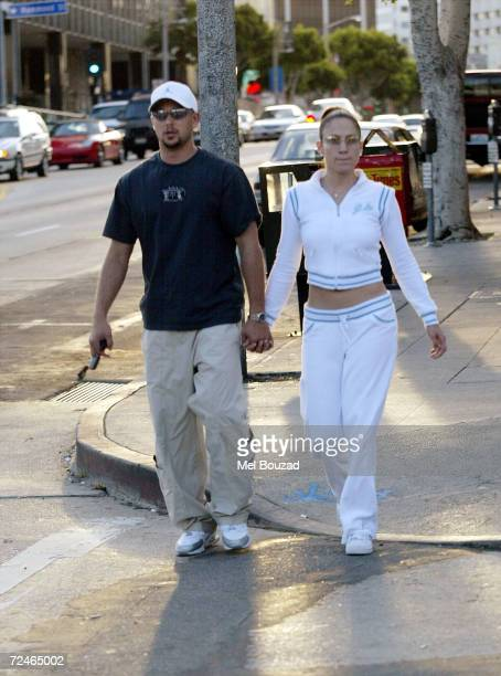 Actress Jennifer Lopez and her husband dancer Cris Judd leave a Pizza place on Sunset Boulevard March 9 2002 in Beverly Hills CA