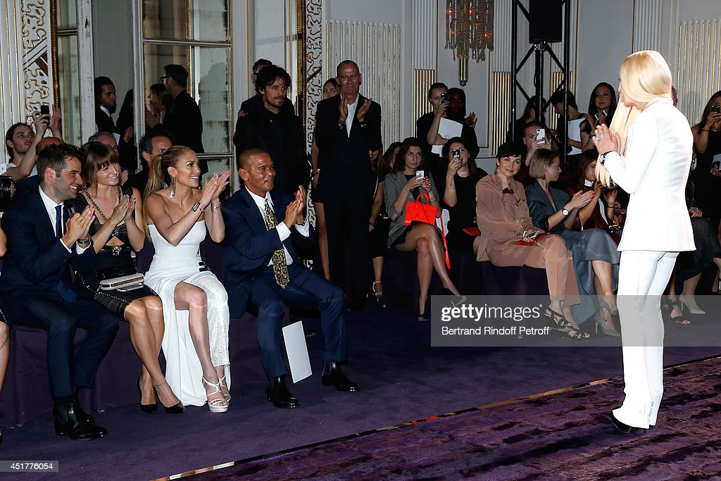Actress <a gi-track='captionPersonalityLinkClicked' href=/galleries/search?phrase=Jennifer+Lopez&family=editorial&specificpeople=201784 ng-click='$event.stopPropagation()'>Jennifer Lopez</a> and public applause <a gi-track='captionPersonalityLinkClicked' href=/galleries/search?phrase=Donatella+Versace&family=editorial&specificpeople=202209 ng-click='$event.stopPropagation()'>Donatella Versace</a> at the end of the Versace show as part of Paris Fashion Week - Haute Couture Fall/Winter 2014-2015 on July 6, 2014 in Paris, France.
