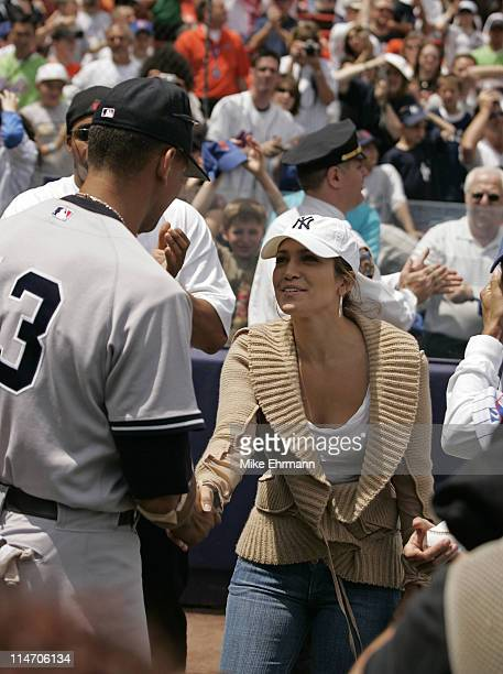 Actress Jennifer Lopez shakes hans with Alex Rodriguez before a subway series game between the New York Mets and the New York Yankees at Shea Stadium...