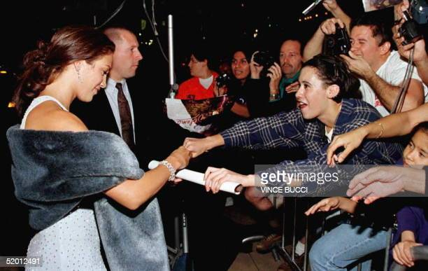 Actress Jennifer Lopez signs a poster for fans as she arrives for the world premiere of the film 'Selena' 13 March in Hollywood Lopez stars in the...