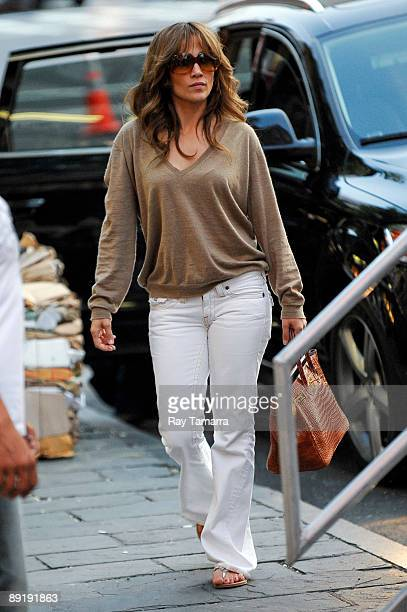 Actress Jennifer Lopez walks to her trailer at 'The Backup Plan' movie set in the Gray's Papaya in the West Village on July 22 2009 in New York City