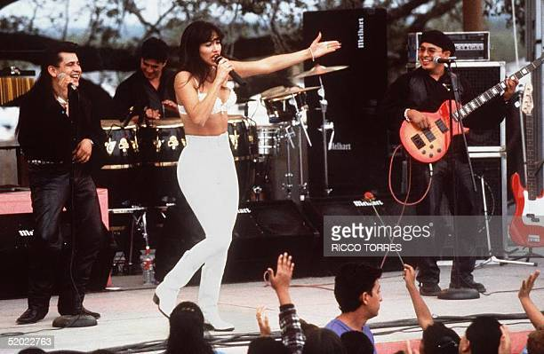 Actress Jennifer Lopez who plays Selena in the movie 'Selena' performs with her band in one of the scenes from the movie 'Selena' is about the tejano...