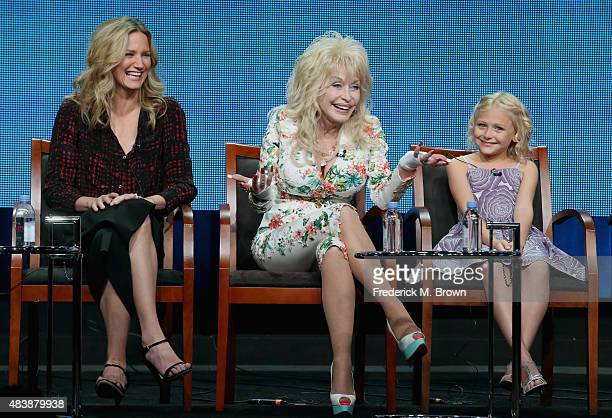 Actress Jennifer Nettles executive producer Dolly Parton and actress Alyvia Alyn Lind speak onstage during NBC's 'Dolly Parton's Coat of Many Colors'...