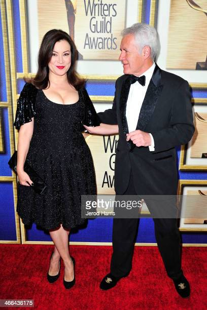 Actress Jennifer Tilly and Alex Trebek arrive at the 2014 Writers Guild Awards LA Ceremony at JW Marriott Los Angeles at LA LIVE on February 1 2014...