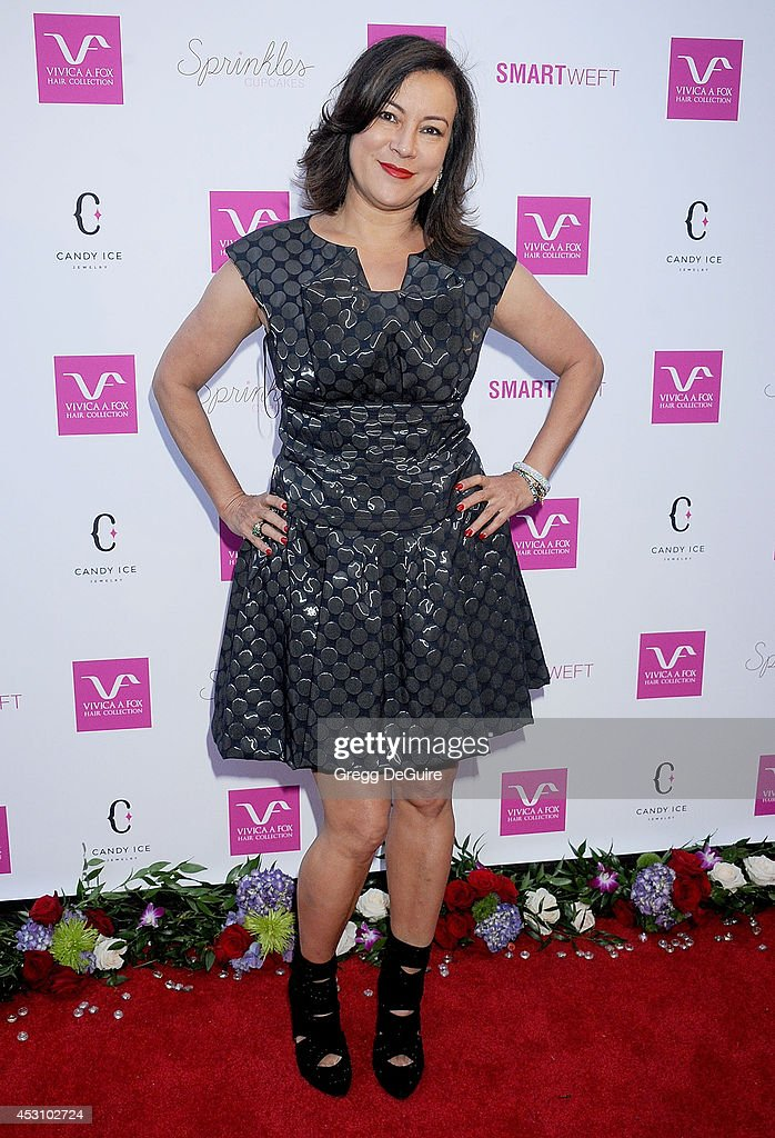 Actress <a gi-track='captionPersonalityLinkClicked' href=/galleries/search?phrase=Jennifer+Tilly&family=editorial&specificpeople=202575 ng-click='$event.stopPropagation()'>Jennifer Tilly</a> arrives at the Vivica A. Fox 50th Birthday party at Philippe Chow on August 2, 2014 in Beverly Hills, California.