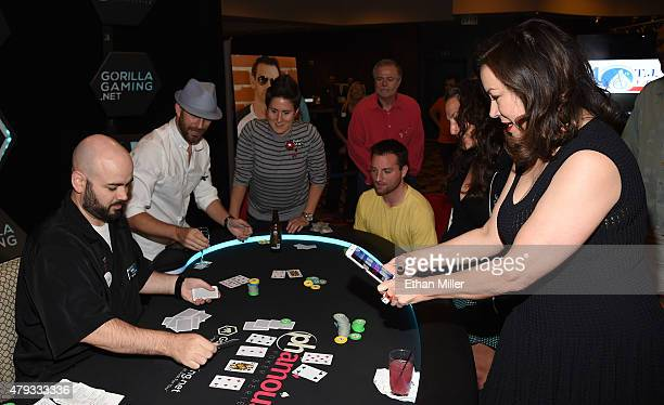 Actress Jennifer Tilly livestreams video at the main table during the TJ Martell Foundation's second annual Chad Brown Memorial Poker Tournament at...