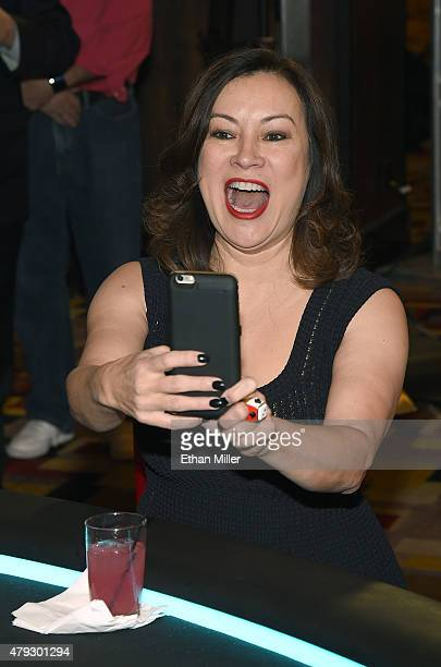 Actress Jennifer Tilly livestreams video during the TJ Martell Foundation's second annual Chad Brown Memorial Poker Tournament at Planet Hollywood...