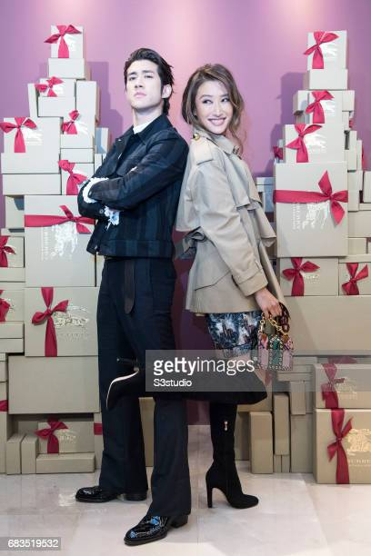 Actress Jennifer Tse and Actor Aarif Lee pose for a photograph on the red carpet at the Burberry Pacific Place event on 03 November 2016 in Hong Kong...