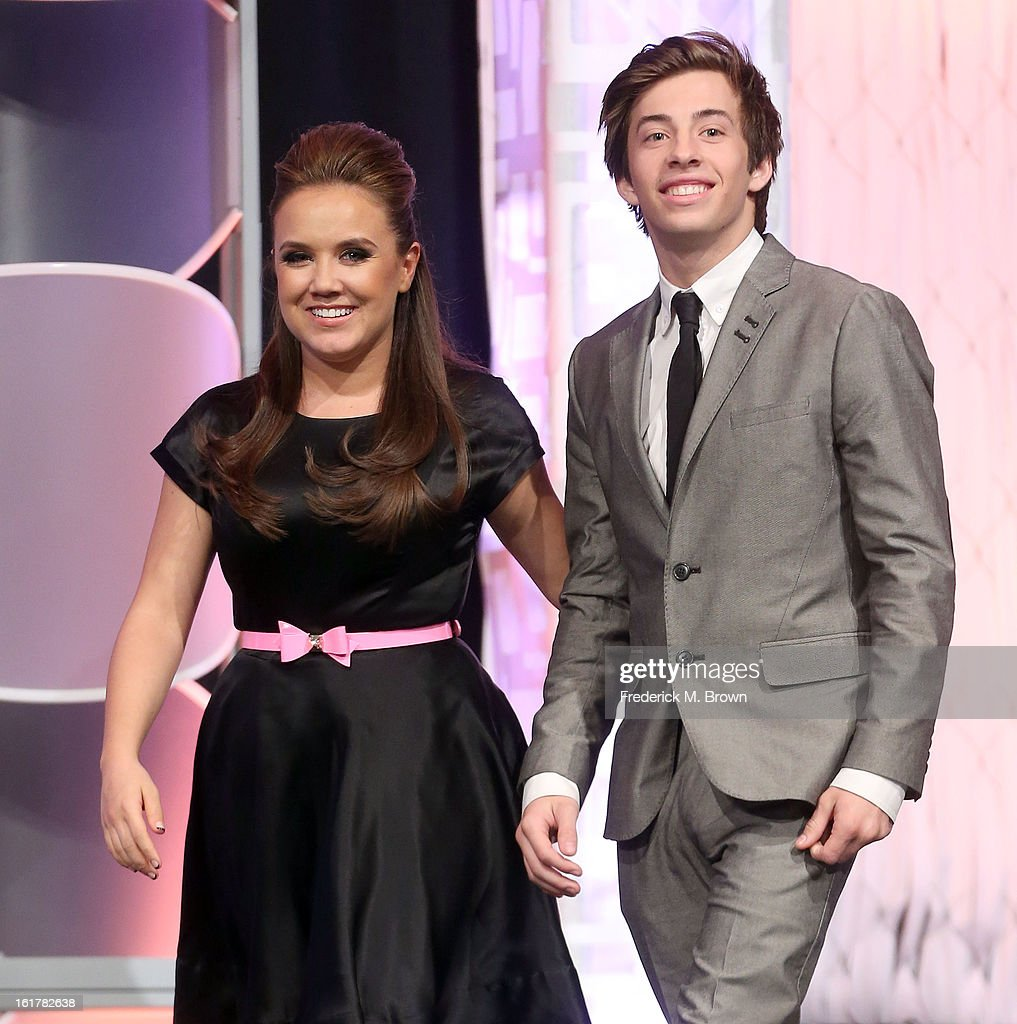 Actress Jennifer Veal (L) and actor Jimmy Bennett speak during the 21st Annual Movieguide Awards at the Universal Hilton Hotel on February 15, 2013 in Universal City, California.