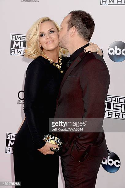 Actress Jenny McCarthy and actor Donnie Wahlberg attend the 2014 American Music Awards at Nokia Theatre LA Live on November 23 2014 in Los Angeles...