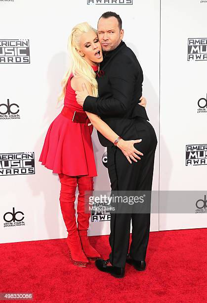 Actress Jenny McCarthy and actor Donnie Wahlberg attend the 2015 American Music Awards at Microsoft Theater on November 22 2015 in Los Angeles...