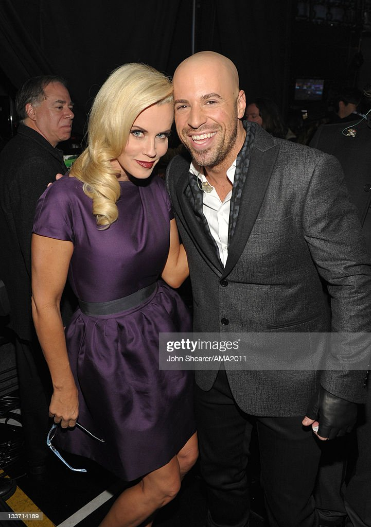 Actress <a gi-track='captionPersonalityLinkClicked' href=/galleries/search?phrase=Jenny+McCarthy&family=editorial&specificpeople=202900 ng-click='$event.stopPropagation()'>Jenny McCarthy</a> (L) and musician <a gi-track='captionPersonalityLinkClicked' href=/galleries/search?phrase=Chris+Daughtry&family=editorial&specificpeople=614842 ng-click='$event.stopPropagation()'>Chris Daughtry</a> pose backstage at the 2011 American Music Awards held at Nokia Theatre L.A. LIVE on November 20, 2011 in Los Angeles, California.