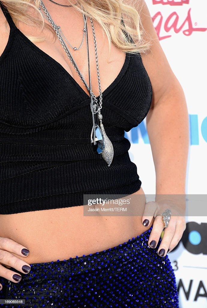 Actress Jenny McCarthy (jewlery detail) arrives at the 2013 Billboard Music Awards at the MGM Grand Garden Arena on May 19, 2013 in Las Vegas, Nevada.