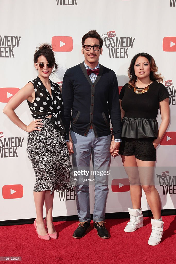 Actress <a gi-track='captionPersonalityLinkClicked' href=/galleries/search?phrase=Jenny+Slate&family=editorial&specificpeople=6250499 ng-click='$event.stopPropagation()'>Jenny Slate</a> (L) and comedian Kassem Gharaibeh (KassemG) (C) arrive at the YouTube Comedy Week Presents 'The Big Live Comedy Show' at Culver Studios on May 19, 2013 in Culver City, California.