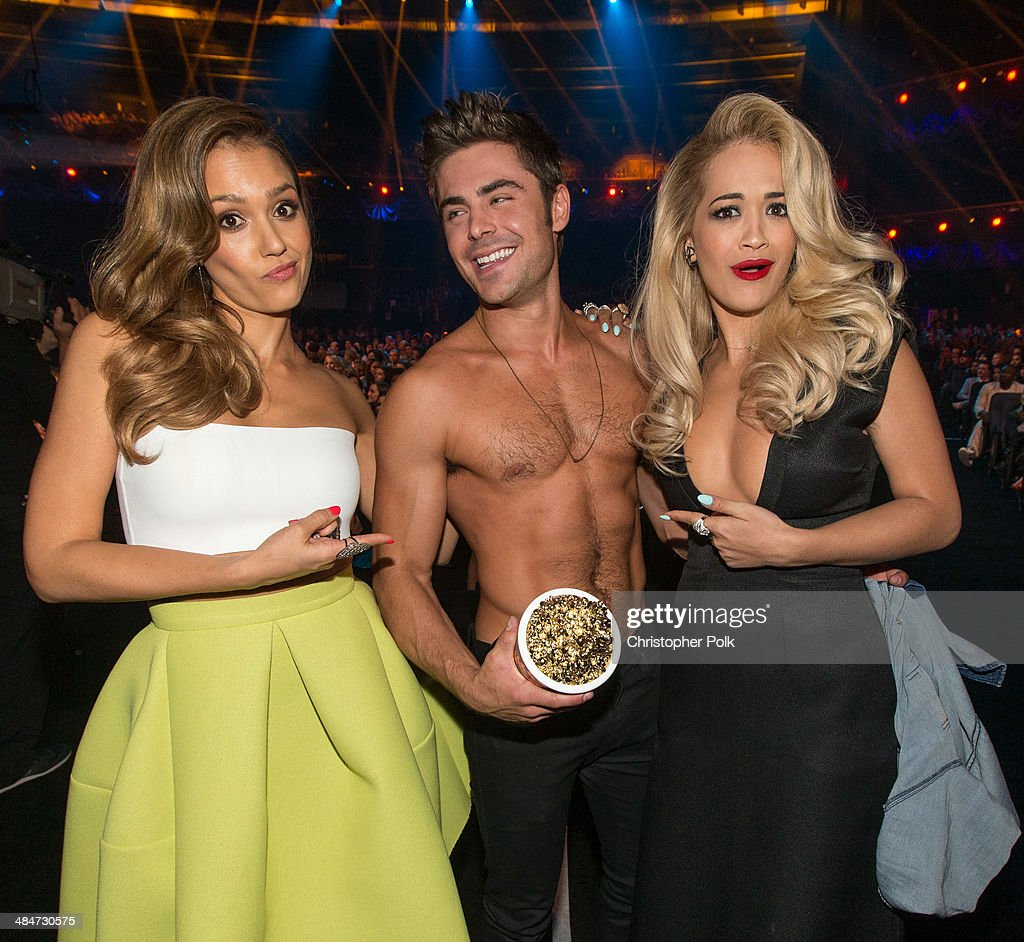 Actress Jessica Alba, actor Zac Efron (holding the Best Shirtless Performance award for 'That Awkward Moment') and recording artist Rita Ora attend the 2014 MTV Movie Awards at Nokia Theatre L.A. Live on April 13, 2014 in Los Angeles, California.