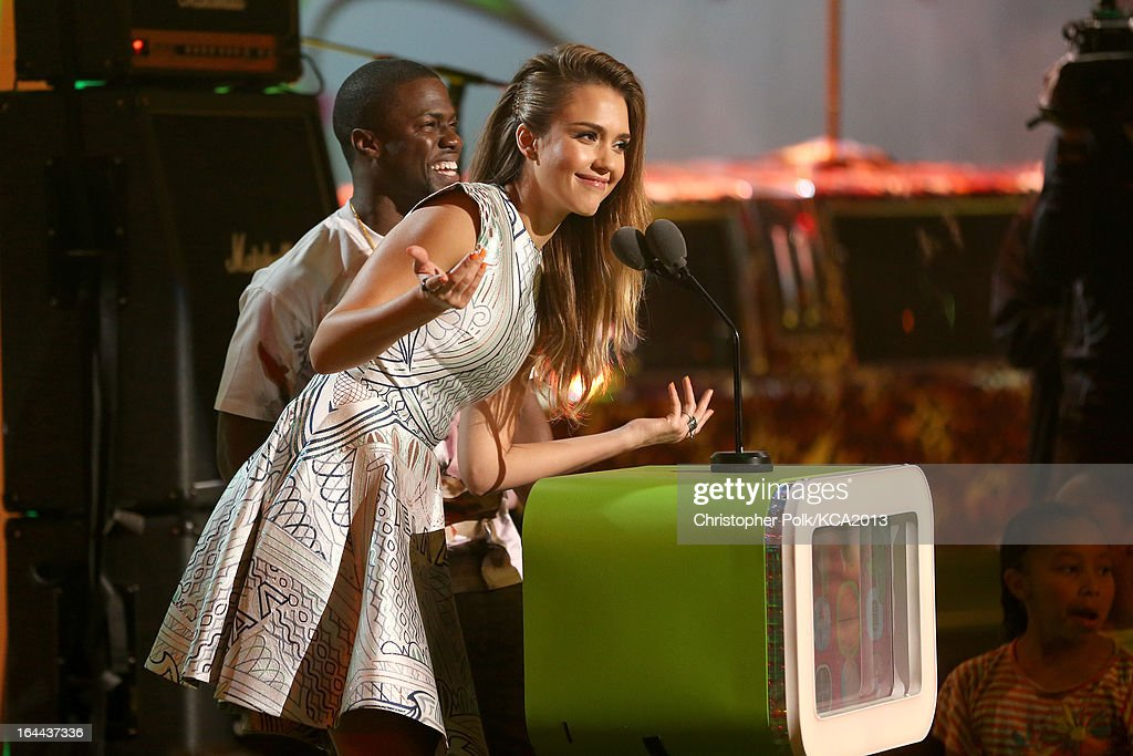 Actress <a gi-track='captionPersonalityLinkClicked' href=/galleries/search?phrase=Jessica+Alba&family=editorial&specificpeople=201811 ng-click='$event.stopPropagation()'>Jessica Alba</a> (R) and actor Kevin Hart speak onstage during Nickelodeon's 26th Annual Kids' Choice Awards at USC Galen Center on March 23, 2013 in Los Angeles, California.