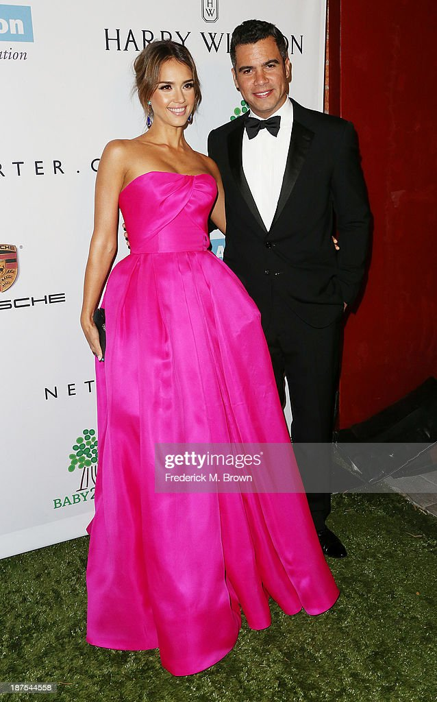 Actress Jessica Alba (L) and Cash Warren attend the Second Annual Baby2Baby Gala at the Book Bindery on November 9, 2013 in Culver City, California.