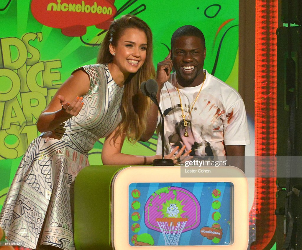 Actress <a gi-track='captionPersonalityLinkClicked' href=/galleries/search?phrase=Jessica+Alba&family=editorial&specificpeople=201811 ng-click='$event.stopPropagation()'>Jessica Alba</a> (L) and comedian Kevin Hart perform during Nickelodeon's 26th Annual Kids' Choice Awards at USC Galen Center on March 23, 2013 in Los Angeles, California.