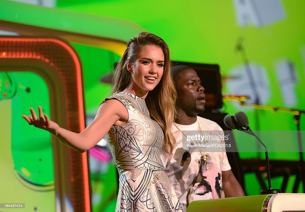 Actress <a gi-track='captionPersonalityLinkClicked' href=/galleries/search?phrase=Jessica+Alba&family=editorial&specificpeople=201811 ng-click='$event.stopPropagation()'>Jessica Alba</a> and comedian Kevin Hart speak onstage during Nickelodeon's 26th Annual Kids' Choice Awards at USC Galen Center on March 23, 2013 in Los Angeles, California.