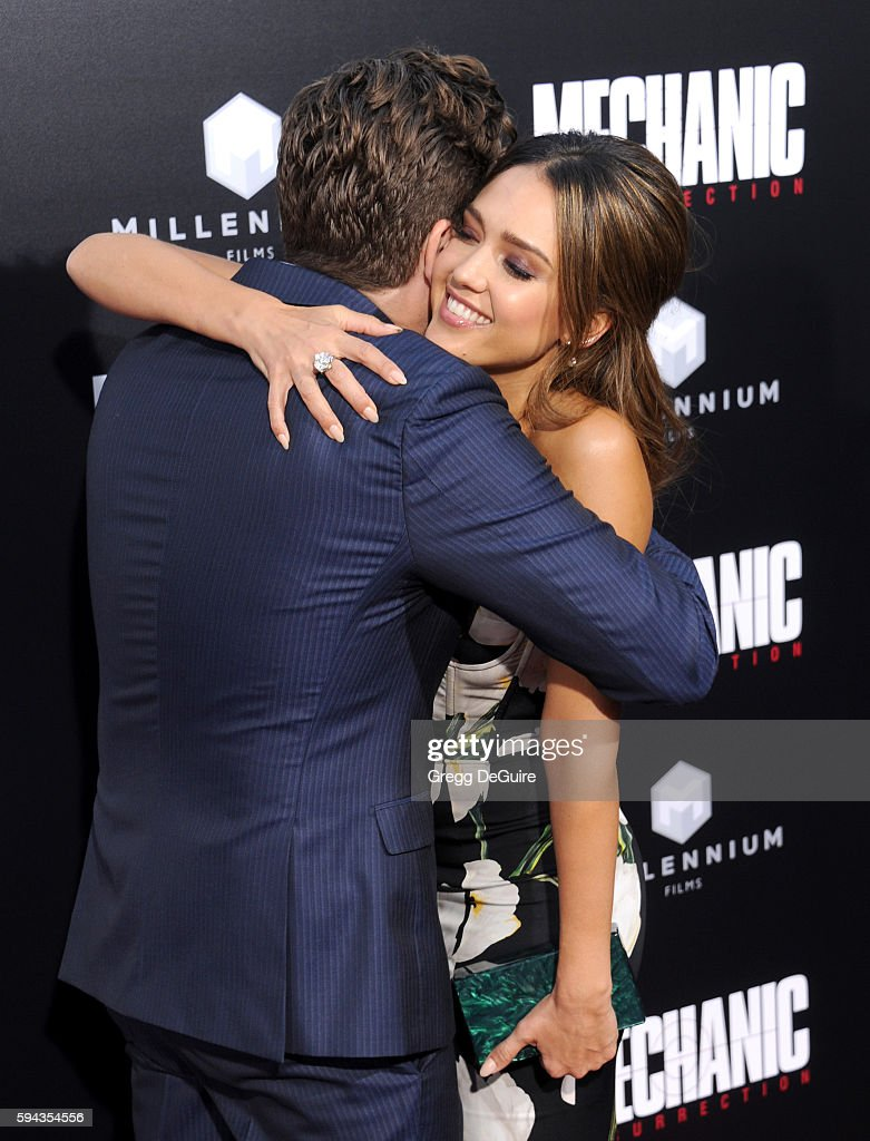 Actress Jessica Alba and director Dennis Gansel arrive at the premiere of Summit Entertainment's 'Mechanic Resurrection' at ArcLight Hollywood on...