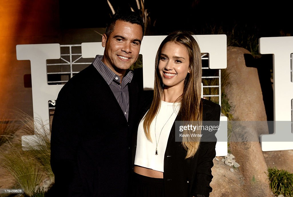 Actress Jessica Alba (R) and her husband Cash Warren arrive at the after party for the opening of Hermes Beverly Hills Boutique at 3 Labs on September 3, 2013 in Culver City, California.