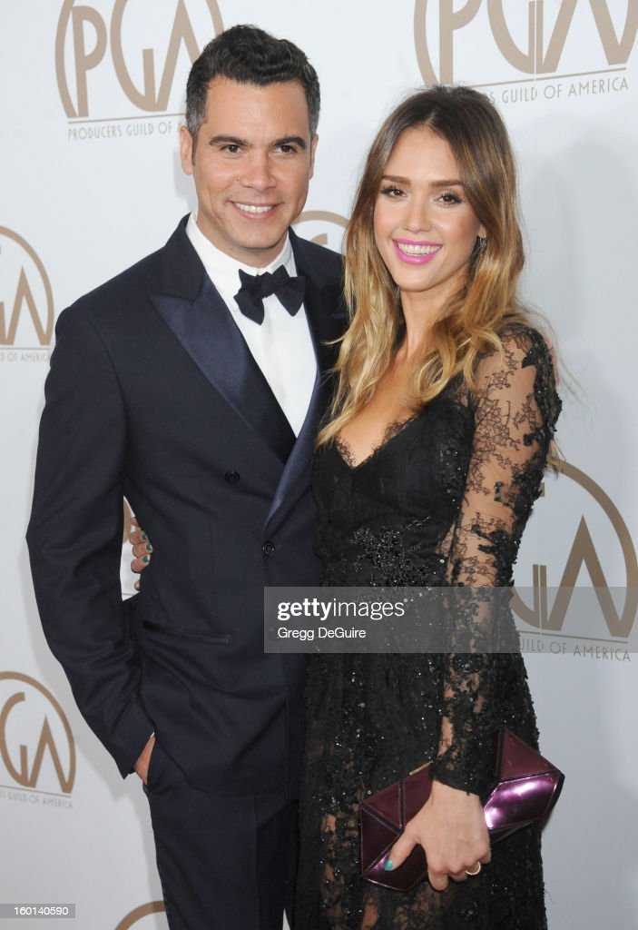 Actress Jessica Alba (R) and husband Cash Warren arrive at the 24th Annual Producers Guild Awards at The Beverly Hilton Hotel on January 26, 2013 in Beverly Hills, California.
