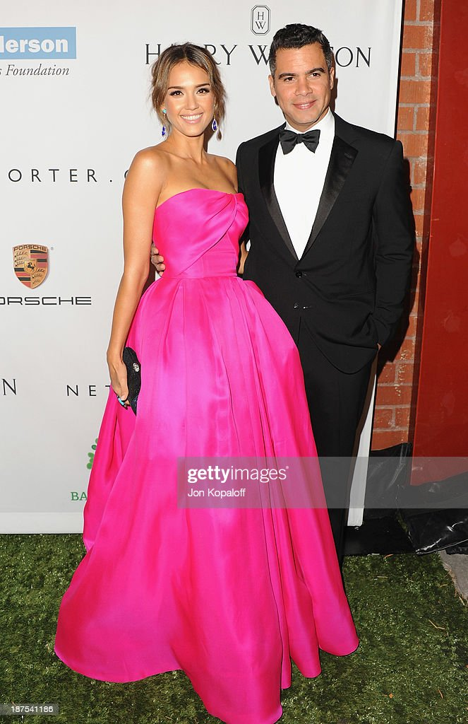 Actress Jessica Alba and husband Cash Warren arrive at the 2nd Annual Baby2Baby Gala at The Book Bindery on November 9, 2013 in Culver City, California.