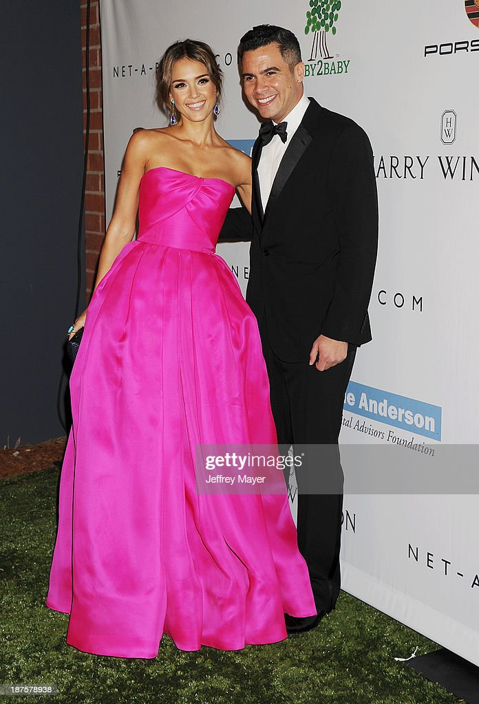Actress Jessica Alba (L) and husband/producer Cash Warren arrive at the 2nd Annual Baby2Baby Gala at The Book Bindery on November 9, 2013 in Culver City, California.