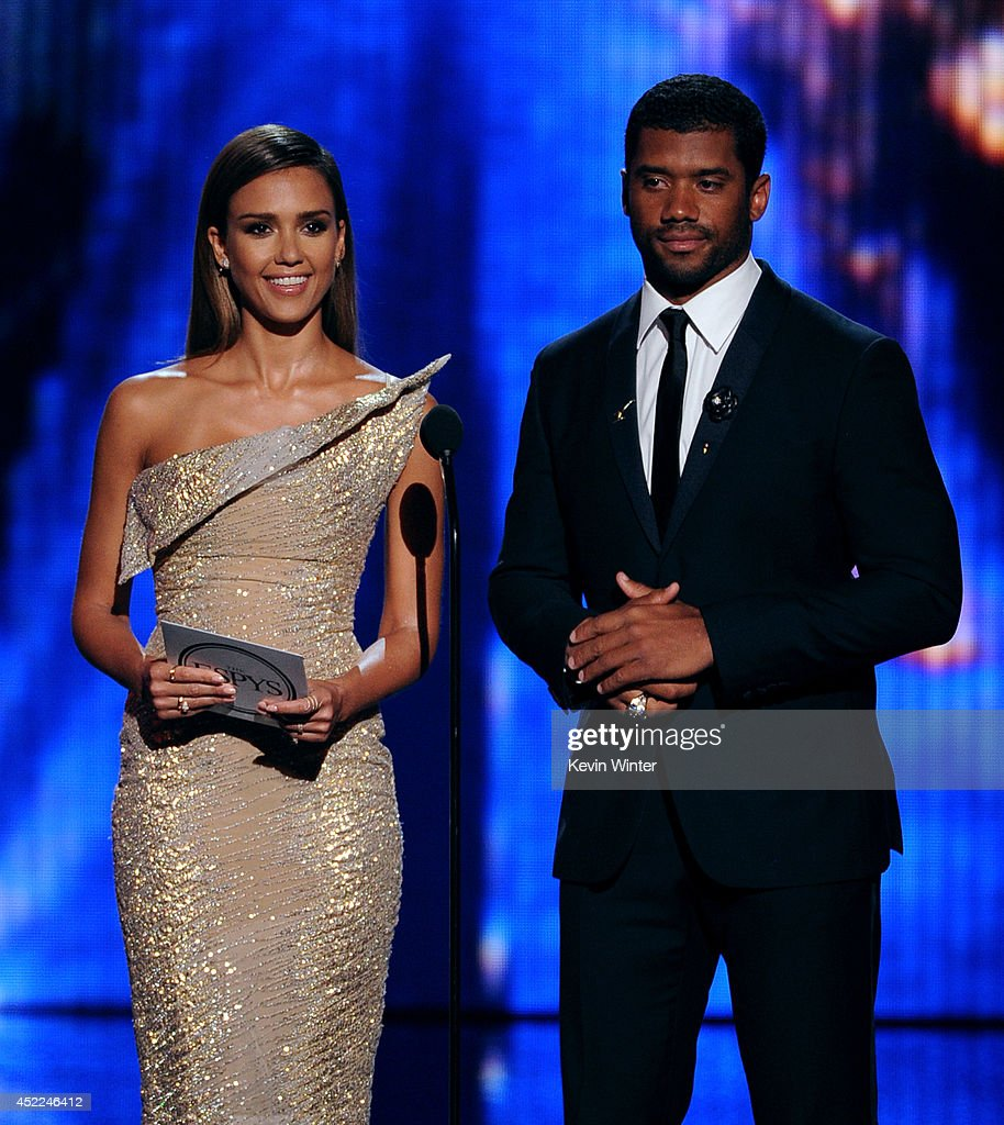 Actress Jessica Alba and NFL player Russell Wilson speak onstage during the 2014 ESPYS at Nokia Theatre L.A. Live on July 16, 2014 in Los Angeles, California.