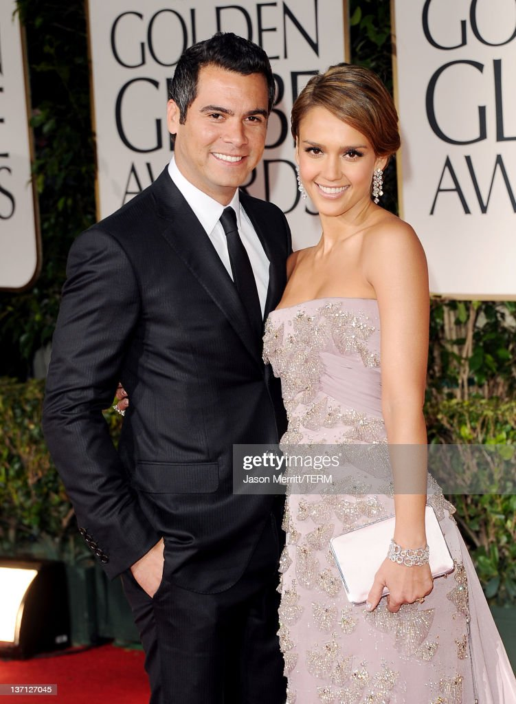 Actress Jessica Alba and producer Cash Warren arrives at the 69th Annual Golden Globe Awards held at the Beverly Hilton Hotel on January 15 2012 in...