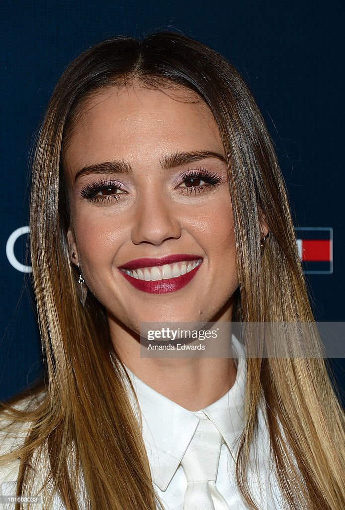 Actress Jessica Alba arrives at the Tommy Hilfiger West Coast Flagship Grand Opening Event at Tommy Hilfiger West Hollywood on February 13, 2013 in West Hollywood, California.