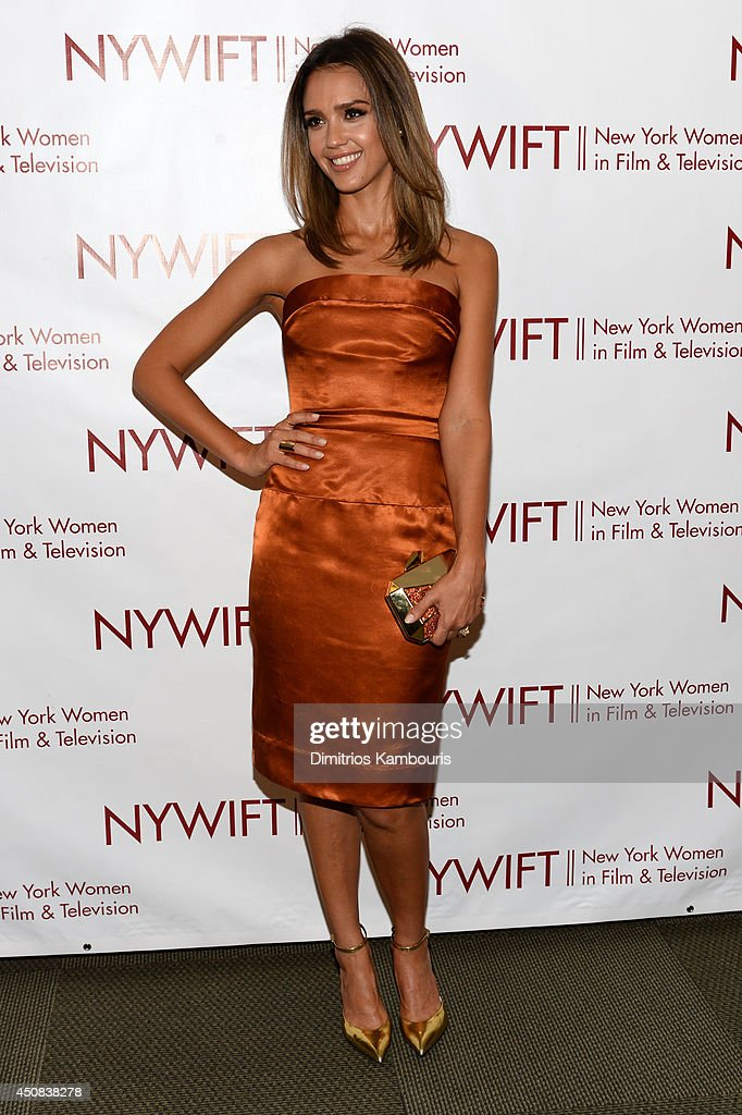 Actress <a gi-track='captionPersonalityLinkClicked' href=/galleries/search?phrase=Jessica+Alba&family=editorial&specificpeople=201811 ng-click='$event.stopPropagation()'>Jessica Alba</a> attends the 2014 New York Women In Film And Television 'Designing Women' Awards Gala at McGraw Hill Building on June 18, 2014 in New York City.