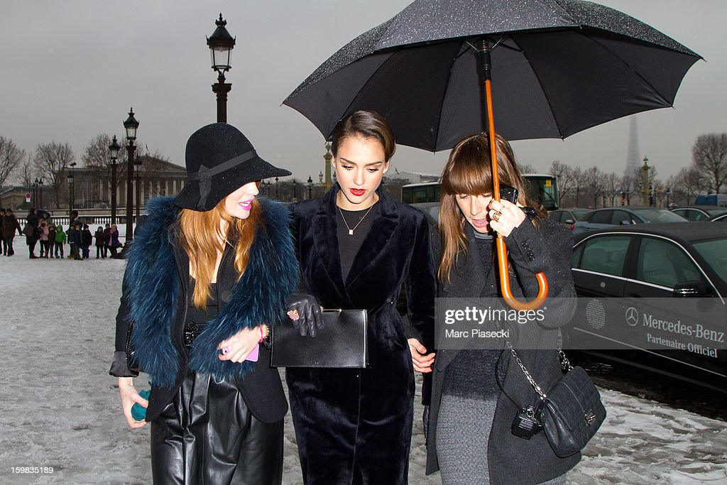 Actress <a gi-track='captionPersonalityLinkClicked' href=/galleries/search?phrase=Jessica+Alba&family=editorial&specificpeople=201811 ng-click='$event.stopPropagation()'>Jessica Alba</a> (C) is seen arriving at the Christian Dior Spring/Summer 2013 Haute-Couture show as part of Paris Fashion Week at on January 21, 2013 in Paris, France.