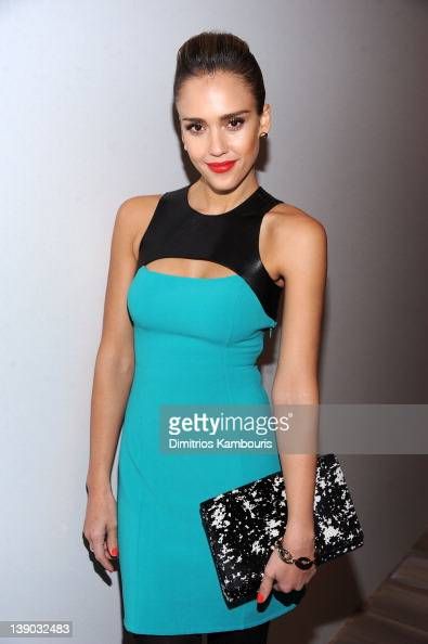Actress Jessica Alba poses backstage at the Michael Kors Fall 2012 fashion show during MercedesBenz Fashion Week at The Theatre at Lincoln Center on...
