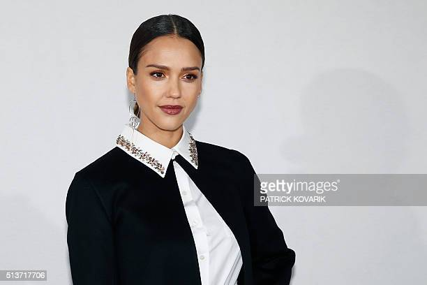 US actress Jessica Alba poses before the Christian Dior fashion show during the 20162017 fall/winter readytowear collection on March 4 2016 in Paris...