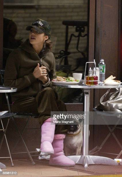 Actress Jessica Alba sits at a restaurant October 21 2005 in New York City