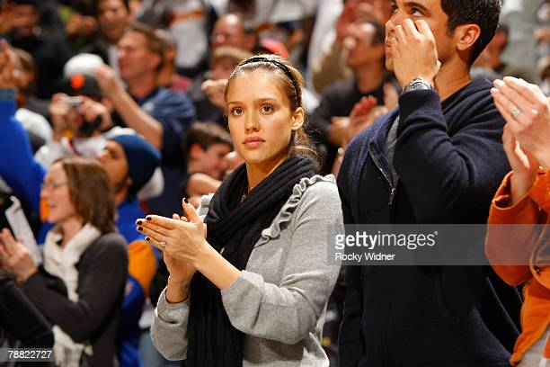 Actress Jessica Alba stands next to her Fiancee Cash Warren clapping after the Golden State Warriors San Antonio Spurs Game on January 7 2008 at...