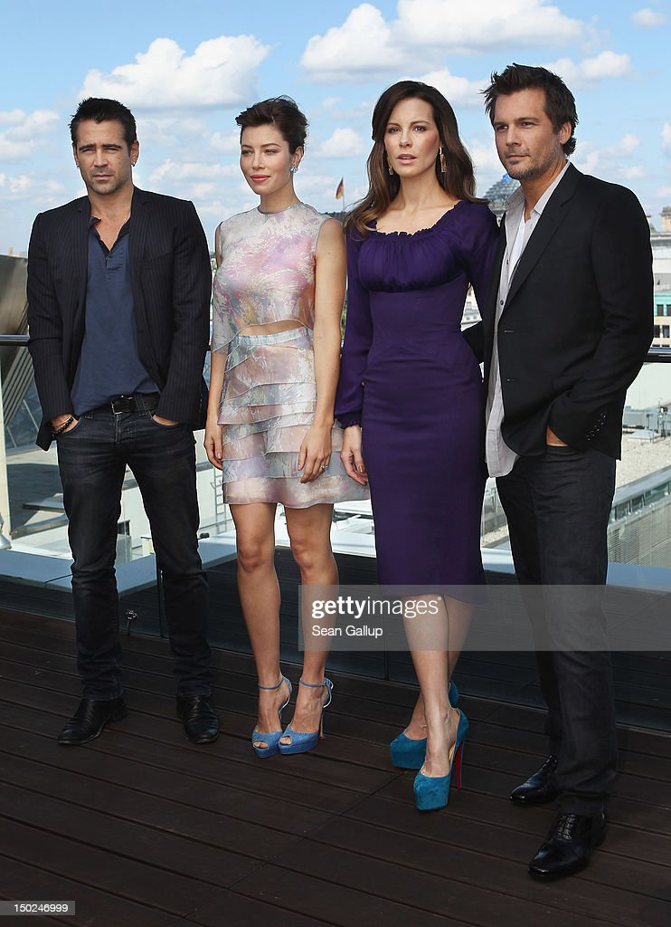 Actress Jessica Biel, actor Colin Farrell, actress Kate Beckinsale and director Len Wiseman attend the Berlin to photocall for 'Total Recall' on the terrace of the China Club on August 13, 2012 in Berlin, Germany.