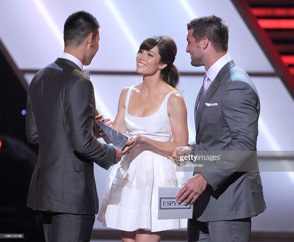 Actress Jessica Biel (C) and NFL player Tim Tebow of the New York Jets (R) present the Best Breakthrough Athlete award to NBA player Jeremy Lin of the New York Knicks onstage during the 2012 ESPY Awards at Nokia Theatre L.A. Live on July 11, 2012 in Los Angeles, California.