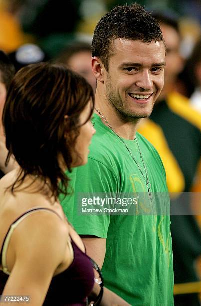 Actress Jessica Biel and singer Justin Timberlake stand on the sidelines before the Green Bay Packers verses the Chicago Bears at Lambeau Field...