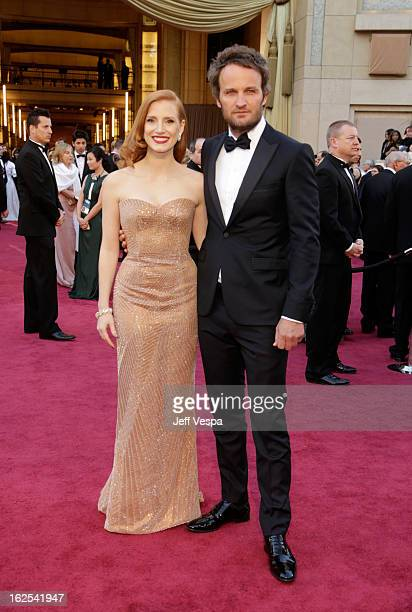 Actress Jessica Chastain and actor Jason Clarke arrive at the Oscars at Hollywood Highland Center on February 24 2013 in Hollywood California
